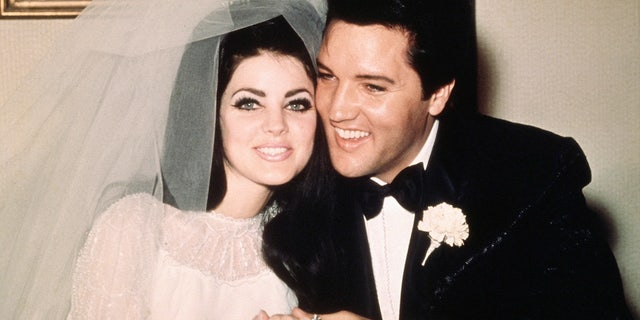 Elvis Presley sits cheek to cheek wit his bride, the former Priscilla Ann Beaulieu, following their wedding on May 1, 1967.